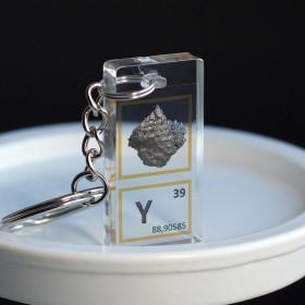 Yttrium keychain